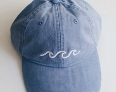 this waves baseball cap is perfect for spring break or for your summer outfit! this waves baseball cap is perfect for spring break or for your summer outfit! Outfit Essentials, Embroidered Baseball Caps, Body Chains, Cute Hats, Silly Hats, Moda Fashion, Blue Fashion, Dad Hats, Hipsters