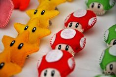 super mario felt make as large pillows to use during tournament and take home as party favor!  or/and make small for use in games