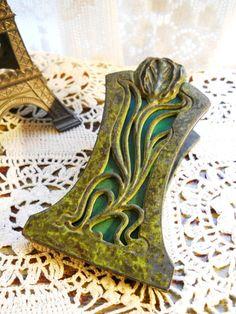 Vintage 1900 rare Apollo Studios Antique Arts and Crafts Art Nouveau Period Bronze Green Slag Glass Desk Letter Paper Clip. via Etsy.