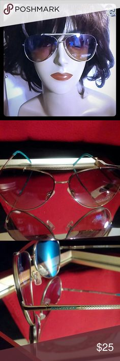 Rocawear Purple Tent Gold Sunglasses New w/tags Rocawear Clear beautiful view purple and gold frame sunglasses with turquoise ear trimming. Authentic! Bundle & Save money and shipping. REASONABLE OFFERS ACCEPTABLE! Accessories Sunglasses