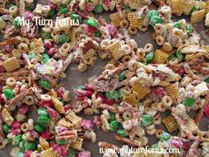 Reindeer Chow:--- 1-Lb White Almond Bark Melting Chocolate* 3-C Rice Chex* 3-C Corn Chex* 3-C Cheerios Toasted Oat Cereal* 2-C Pretzel Sticks* 2-C Dry Roasted Peanuts Or Almonds* 1-12 Oz Bag M&M's Plain Chocolate Candy*--- Slowly Melt Chocolate In Double Broiler Over Water. Combine Remaining Ingredients In A Separate Bowl. Drizzle Chocolate Over Top & Mix Well. Spread In A Shallow Layer On A Cookie Sheet. Allow To Cool Completely. Pkg In Single-Serving Bags. Click On Picture.
