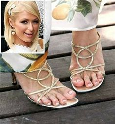 Paris Hilton's feet! Oh dear Bunions - ouch looks painful!! if you would like to be able to wear shoes, sandals and boots again without being in pain take a look at Meanfeet's range of Wide Fitting Bunion Relief Footwear at www.meanfeet.com