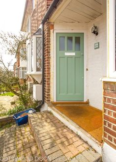 Green 1930s front door with simple textured obscure glass.   Fully painted door and frame.