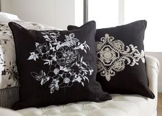White stitching on a black field makes any design pop; just look at how it enhances the romantic and delicate floral pattern adorning this pillow. Exquisite detail lends dimension and brings the desig