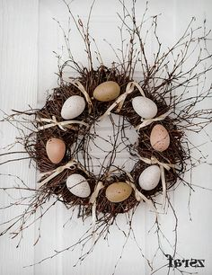 Bird's Nest Wreath....use a small nest with eggs instead of these large ones...note to self...elj