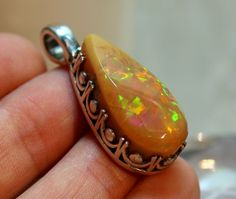 Opal Pendant, Ethiopian Opal, Sterling Silver, Yellow Opal, Gemstone Jewelry, Metaphysical, Opal  Necklace, Rough Opal, Raw Opal by SagesLeaf on Etsy https://www.etsy.com/ca/listing/477411989/opal-pendant-ethiopian-opal-sterling