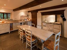 A feature dining table in the kitchen Aga Kitchen, Country Kitchen, Aga Recipes, Cottages In Wales, Holiday Cottages To Rent, Country Cottage Interiors, Log Burning Stoves, English Decor, Brecon Beacons