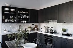 Grey home with a black kitchen