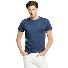 Tommy Hilfiger men's tee. Our tee has been garment dyed to achieve that worn-it-forever look and feel. To keep things interesting, we added a chest pocket in traditional menswear shirting fabric. <br>• Classic fit.<br>• 100% cotton. <br>• Ribbed collar, microflag on sleeve.<br>• Machine washable.<br>• Imported.