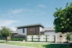 An espaliered climber adorned the front fence, softening the overall look. Villa, Front Fence, Australian Homes, Landscape Design, House Plans, Cool Designs, Garage Doors, Farmhouse, House Styles