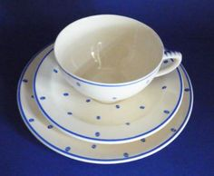 Susie Cooper Crown Works Pottery John Lewis Blue 'Polka Dot' Trio c1935.   A classic Susie Cooper design of simple dots, striped handles and lining in Blythe blue enamel. Made for John Lewis and Peter Jones department stores