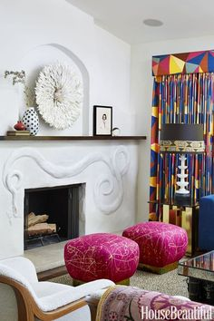 """The living room is oriented around a fireplace mantel embellished by decorative artist Kaveri Singh. """"The curving snake relief is both subtle and engaging,"""" Luetkemeyer says. The Bamileke feather headdress is from Nickey Kehoe. Restoration Hardware Sofa, Leontine Linens, Hollywood Homes, Back Painting, How To Make Headbands, Custom Sofa, Beautiful Homes, House Beautiful, Home Accents"""