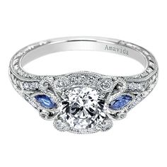 Gabriel & Co. Amavida Platinum Victorian Halo Engagement Ring accented with quality sapphires. This vintage styled engagement ring has simplicity in style but holds much statement and beauty in its details. Vintage Style Engagement Rings, Platinum Engagement Rings, Wedding Rings Vintage, Engagement Jewelry, Engagement Ring Settings, Vintage Rings, Vintage Jewelry, Vintage Bridal, Gatsby Wedding