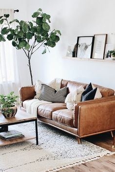"""Timber Charme Tan Sofa - Dascha - Timber Charme Tan Sofa """"The living room is finally almost complete and this sofa is definitely the star of the show."""" The Timber Charme Tan leather sofa will do that. Photo by Lynette Yoder. Boho Living Room, Living Room Sofa, Apartment Living, Home And Living, Living Room Furniture, Modern Living, Modern Furniture, Rustic Furniture, Living Rooms"""