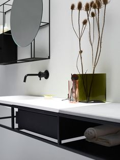 Frame is a modular system of bathroom consoles and furniture. Featuring a straight and minimalist design, it turns as a delicate graphic piece with a Nordic allure. Frame is a flexible system consisting of a number of black graphic frames, customisable depending on your needs and with a functional purpose. The main steel structure is designed to accommodate the basin as well as a counter top in various material such as wood, LivingTec®, marble and stone. Created for www.ex-t.com.