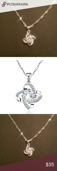 Stunning Silver knot necklace NWOT. Beautiful silver necklace with a large zircon at the center and a knot with smaller cz's adorning the four loops. Really stunning. Sterling silver. Jewelry Necklaces