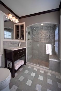 """Designed by Monica Miller, CKD, CBD, CR   Photography by Michael Houghton StudiOhio     Products:   Kohler plumbing fixtures and faucets   Hudson Valley H653PC light fixture   Carerra marble vanity top and bench seat   Shiloh Vanity cabinet   Mosaic - Anatolia glass / stone blend in """"Iceland"""""""