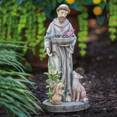 """Saint Francis Bird Feeder-Saint Francis with Fox and Rabbit. Francis welcomes birds to feed from his bird feeder. This statue is inscribed with """"Joy Peace Love Faith"""". It is made of Polystone for indoor or outdoor use. Francis Of Assisi, St Francis, Saints, Life Size Statues, Fox And Rabbit, San Francisco, Garden Statues, Garden Sculptures, Colorful Garden"""