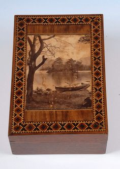 A rectangular box with an applied photographic print within a geometric border. Unlike the majority of boxes with photographic prints this view does not appear to be on the Isle of Wight but is more likely to be in The Lake District or Scotland. (England c. 1890) Offered by Amherst Antiques at The Edenbridge Galleries, Kent. www.edenbridgegalleries.com