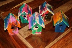 Mini wooden bird houses. Painted with liquid water paint. Preschool craft.