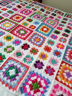 Newly listed and available now for immediate dispatch. White dolly crocheted granny squares blanket.