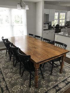 This Country French Turned Leg Table from James+James is customized with a smooth jointed top in Early American Stain and a Semi Gloss Sheen. The Painted Black Rustic Windsor Dining Chair creates a beautiful contrast to this made to order dining table.  Let the hundreds of photos in our Customer Gallery give you ideas for your customization choices, and receive a real-time quote on our website as you customize your dining room furniture!