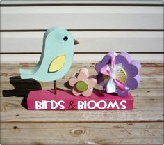 Birds and blooms flower wooden spring and easter decoration, via Etsy.