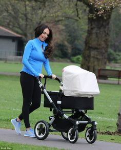 Tamara takes baby Sophia for a walk through Kensington Gardens