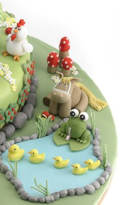 fondant frog, fondant pond, fondant duck, fondant cockerel, fondant chicken, fondant toadstool, fondant horse Fondant Horse, Fondant Animals, Fondant Icing, Fondant Cupcakes, Barnyard Cake, Farm Cake, Wedding Cakes With Cupcakes, Wedding Cakes With Flowers, Flower Cakes