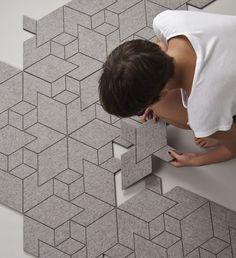 """Peter Simonik et Elena Bolcekova du studio de design slovaque Allt ont conçu """"Cityscapes"""", un tapis composé de modules en feutre gris béton sur support caoutchouc."""