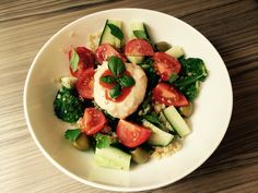 Bulgar wheat and broccoli salad with steamed spinach, tomato, cucumber, olives and white bean dip with chilli sauce.