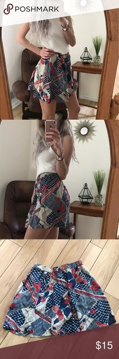 Floral Skirt Cute red, cream and blue floral print skirt from Urban Outfitters. Has an elastic waistband. Size S Urban Outfitters Skirts Mini