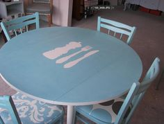 And of course you could paint the kitchen table if it has seen better days... This one's got simple stencils in the middle.