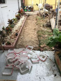 A couple saves ice cream buckets & look what they do to their walkway!