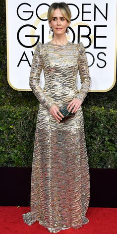 Our Top 10 Best Dressed Women at the 2017 Golden Globes:: Sarah Paulson in a tight-fitting long-sleeve dress covered in waves of gold and silver sequins courtesy of Marc Jacobs.