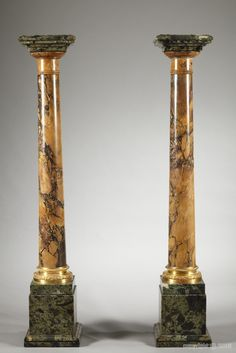Pair of yellow Siena marble columns, obelisk types, with Doric Capitals in green marble and with gilt bronze Base, finely carved with a crown of laurels and braces. Each column is based on a high pedestal, square shaped in green marble. Louis XVI style, Circa 1790 - Dim: L: 21cm, D: 21cm, H: 116cm.