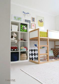 I'm not sure if there would be room to put in a 8 cube shelf in M's room, but love the added storage.
