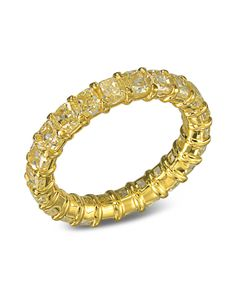 5eedd73f359b3 An 18K yellow gold eternity band with radiant cut diamonds.The diamonds are  5.48 CTW