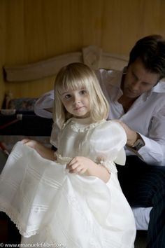 Princess Vittoria of Italy  Look at the precious little girl and her daddy fixing her dress.