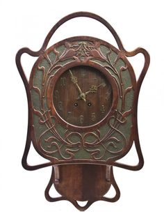 Lot: 2538: An American Art Nouveau Oak Clock, Height 26 inch, Lot Number: 2538, Starting Bid: $70, Auctioneer: Leslie Hindman Auctioneers, Auction: Marketplace Day 1, Date: August 22nd, 2012 UTC