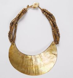 """Antique New Guinea 'Kina"""" shell pectoral ornament, gold branch coral multi-strands with antique Chinese mother of pearl button. Similar designs available, please inquire: tamara.e.hill@gmail.com"""