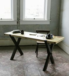X Base Reclaimed Maple Work Table by Kith & Kin on Scoutmob Shoppe. This polished desk has great industrial feel, with its light maple top and darker oak base.
