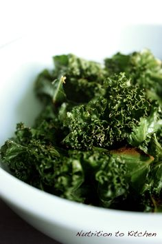 Spicy, Crispy Kale Chips (curried) - Nutrition to Kitchen. I love kale chips but they are hella expensive at Whole Foods and I wanted a lower carb version than the Rhythm Bombay Curry ones that I LOVE.
