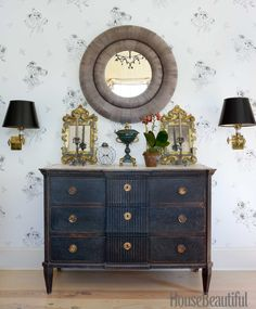 A mirror from Balsamo is flanked by a pair of Italian gilded wood mirrors on a chest of drawers from Cupboards
