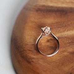 Start your happily ever after on a sweet note with this forever brilliant moissanite engagement ring set from Camellia Jewelry. Scrupulously handmade in fine detail, it is a unique moissanite wedding ring set that will show her how much you care without b Wedding Rings Simple, Simple Rings, Delicate Rings, Dream Ring, Solitaire Engagement, Timeless Engagement Ring, Engagement Ring Settings, Engagement Bands, Timeless Wedding