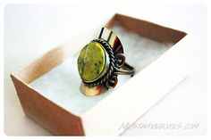 February 2014 Fair Treasure Box: Greenola Style Calypso Ring. The ring features an eye-catching Adventurine Green semi-precious stone against a silver colored plate.  I love the earthy bohemian look of this piece! Price: USD $16.00 -- #beauty #fairtreasure #home #subscriptionbox #accessories #lifestyle #fairtrade #jewelry