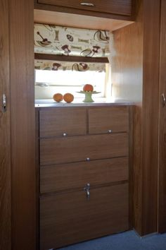 Bedroom cabinets re-faced in teak for Lorrie's vintage Airstream...