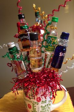 Made this last night for Christmas gift  exchange for adults. 12 mini bottles for 12 days Christmas