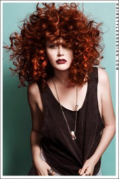 Hair Style : This amazingly huge afro is gorgeous. It's big, bold, and beautiful. And the coloring is to die for!  Hair Cut : Big, Culy and amazing.  Hair Colour : Fire Engine Red.