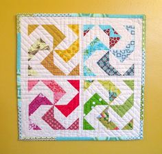 Half square triangles make this fun looking quilt